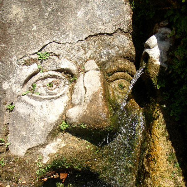 Fountain designed to look like human faces